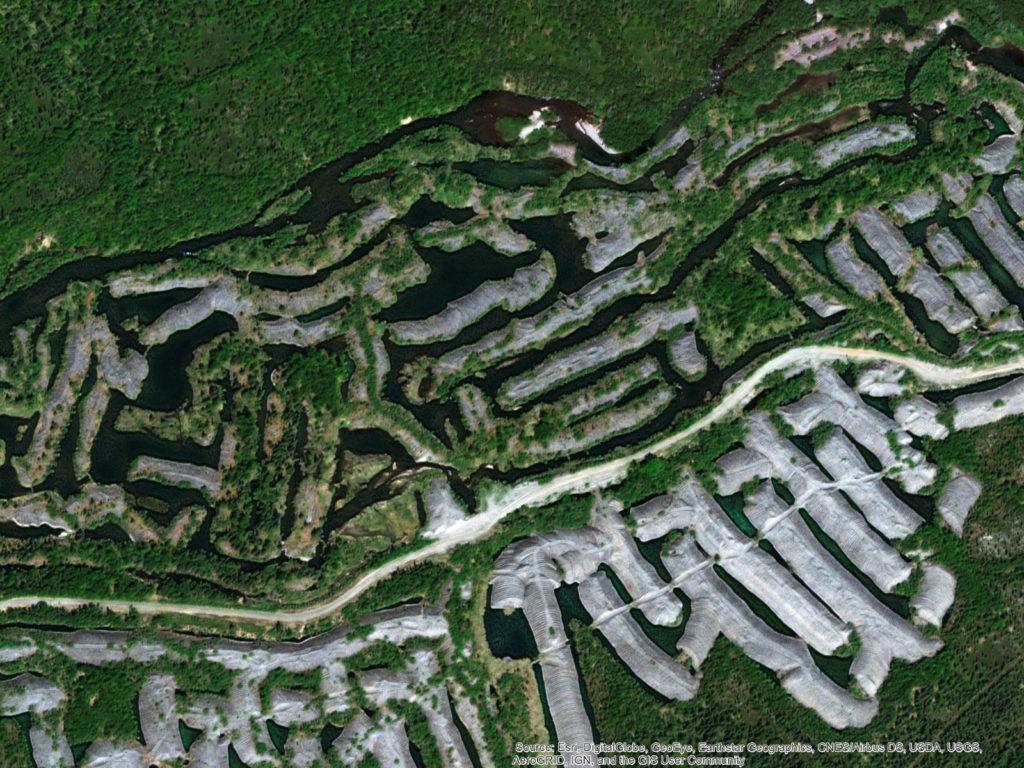 Photograph illustrating the mining footprint around the Tuluksak River in Alaska